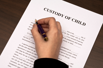 person filling out child custody form